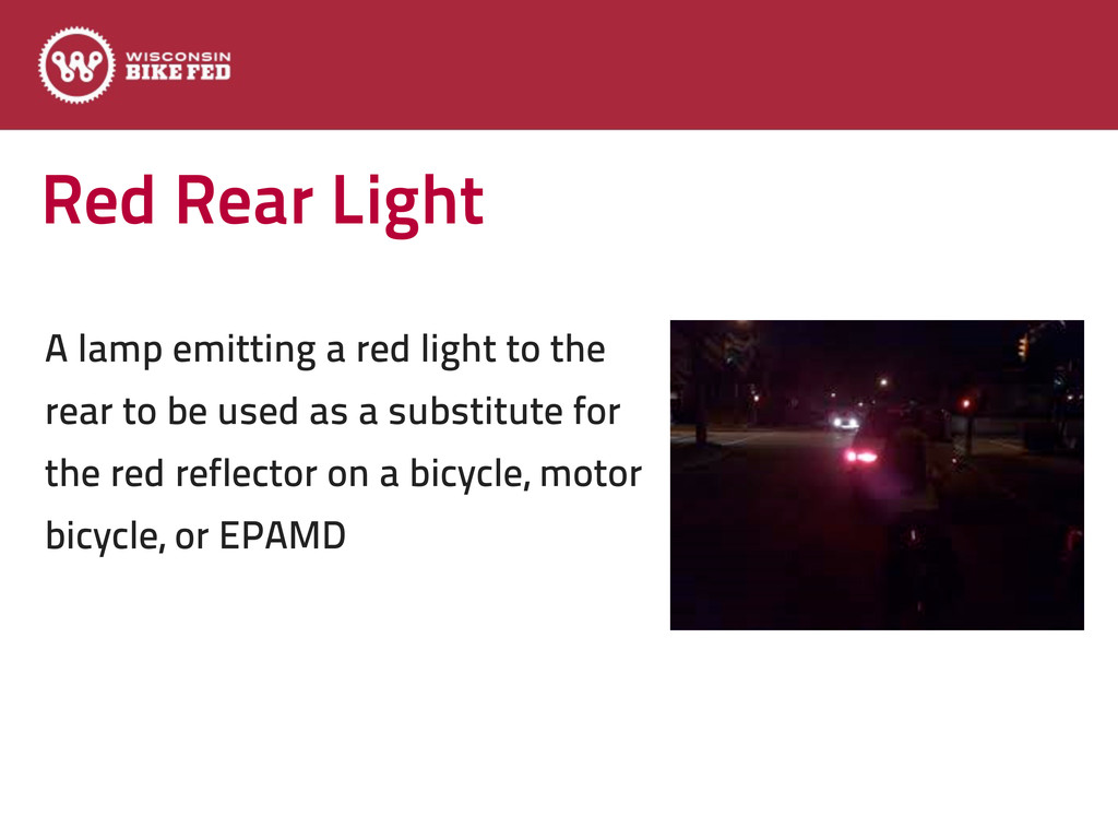 Red Rear Light A lamp emitting a red light to t...