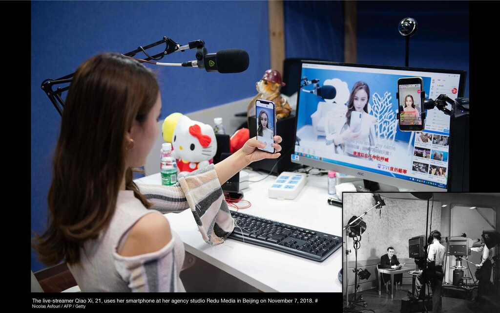 The live-streamer Qiao Xi, 21, uses her smartph...