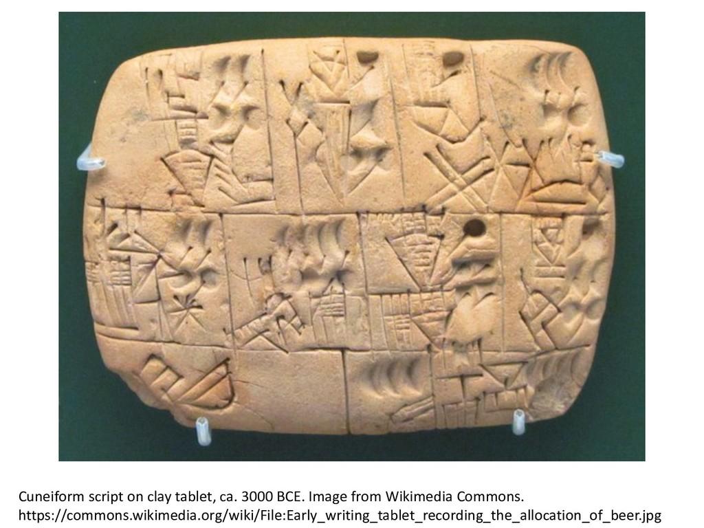 Cuneiform script on clay tablet, ca. 3000 BCE. ...