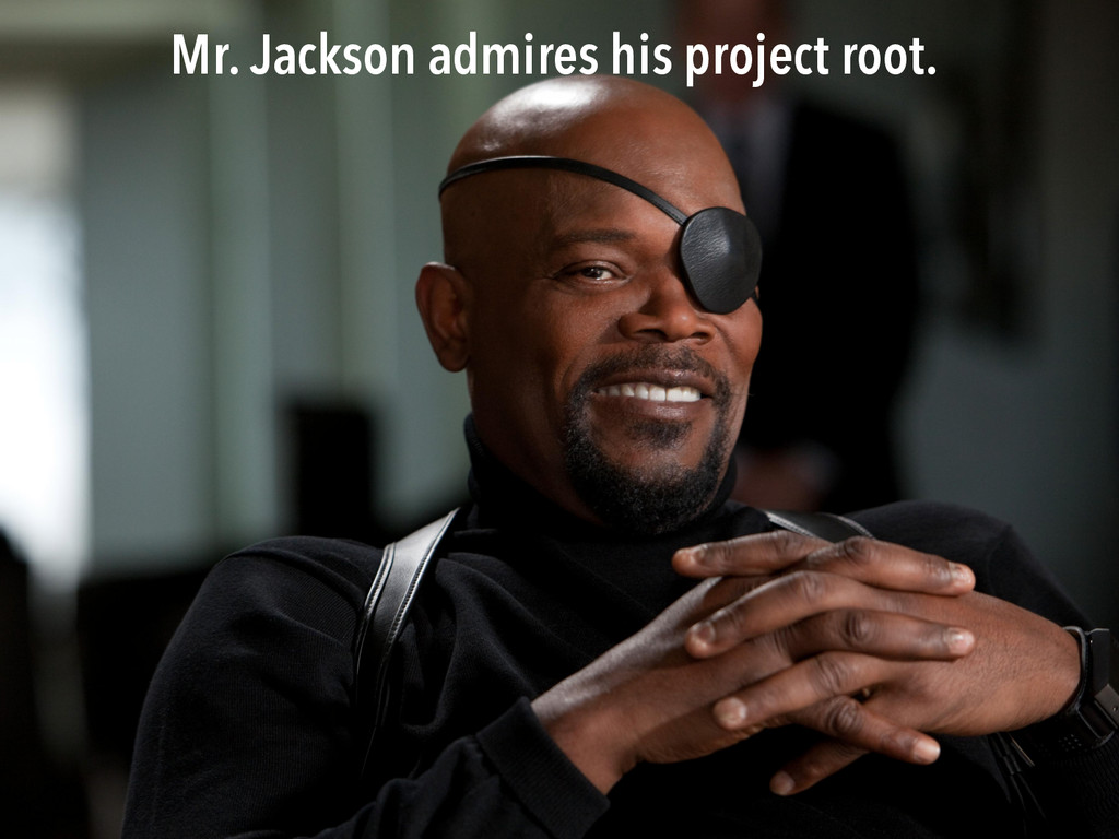 Mr. Jackson admires his project root.