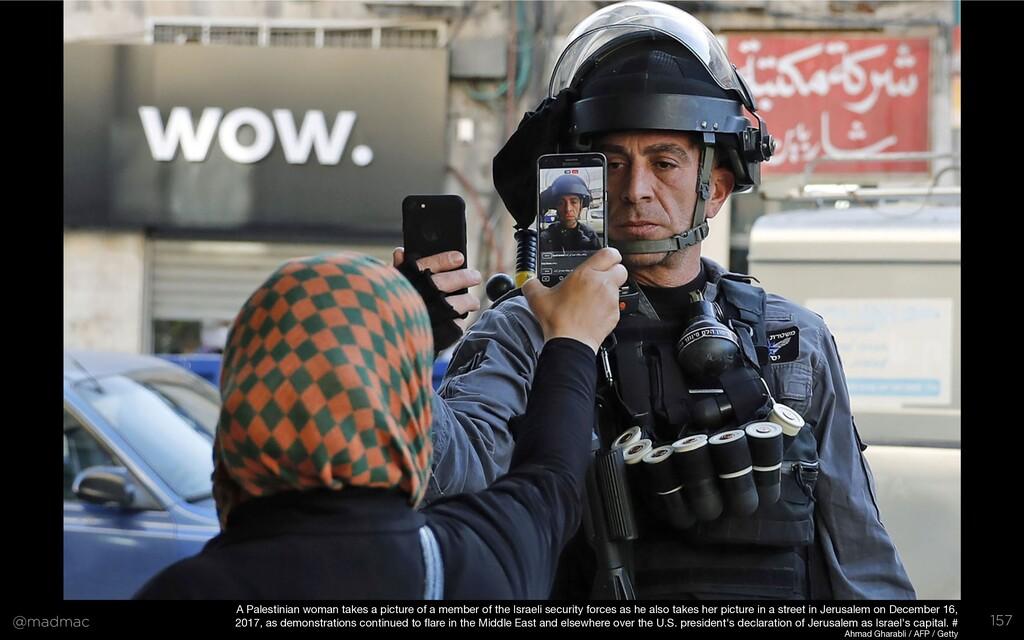 @madmac 157 A Palestinian woman takes a picture...