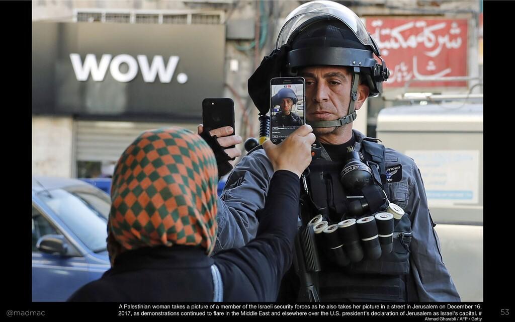 @madmac 53 A Palestinian woman takes a picture ...