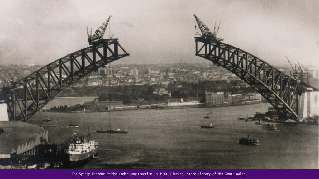 The Sydney Harbour Bridge under construction in...