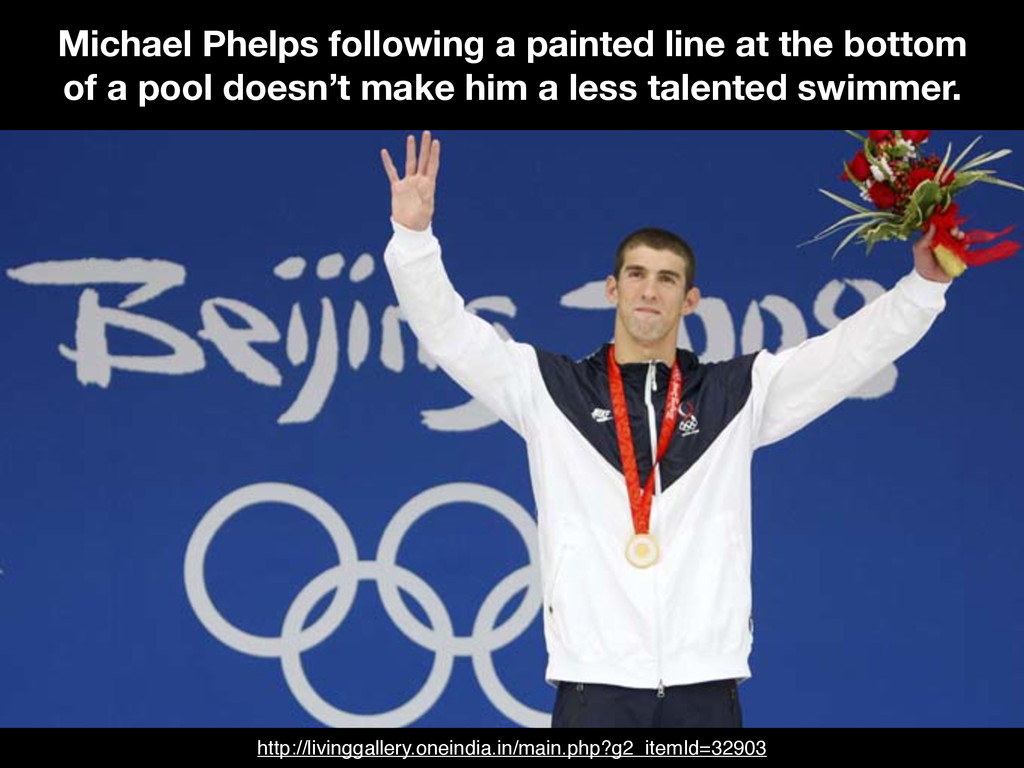 Michael Phelps following a painted line at the ...