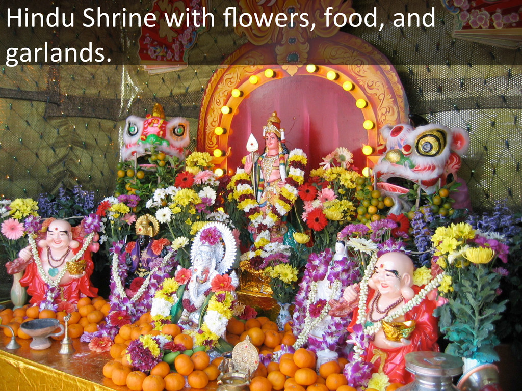 Hindu Shrine with flowers, food, ...