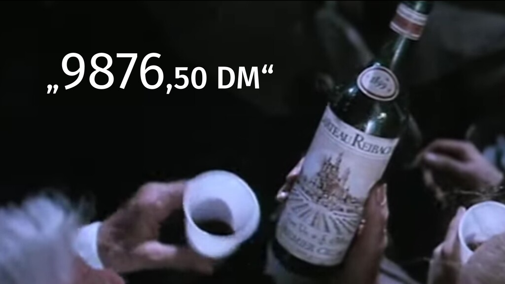 """9876,50 DM"""