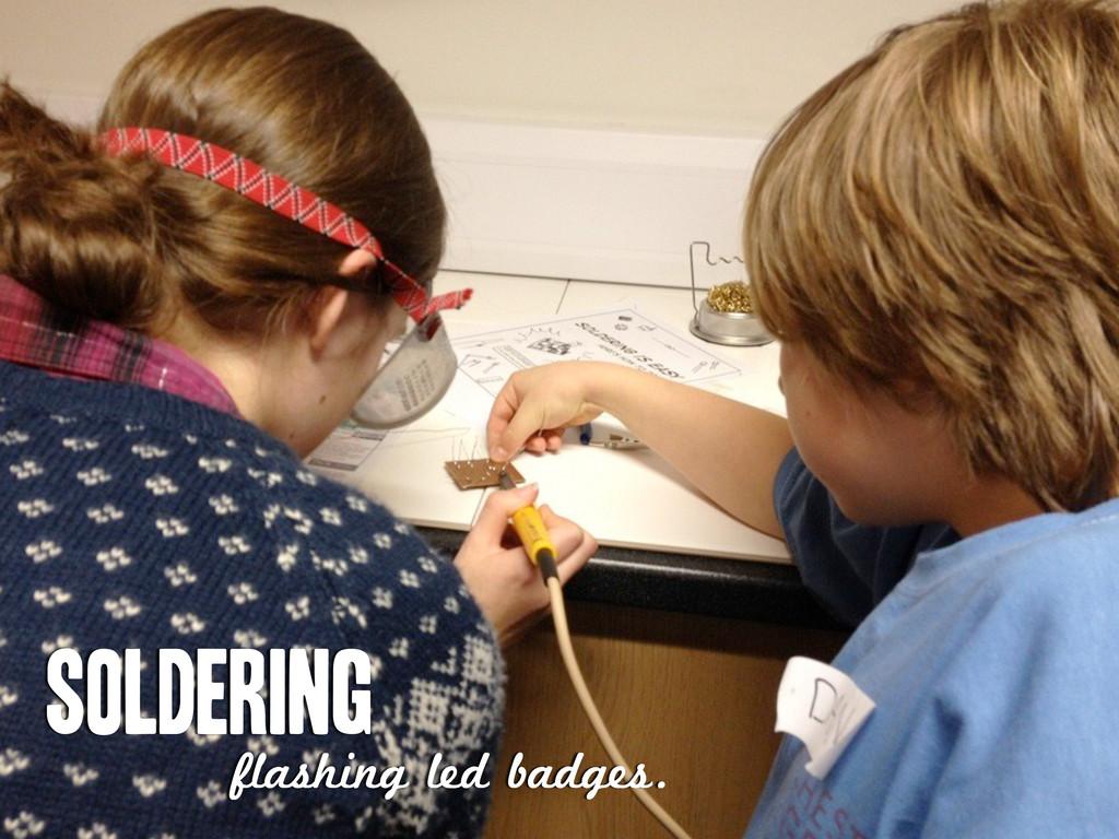 Soldering flashing led badges.