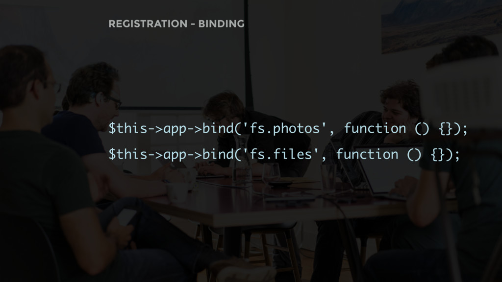 $this->app->bind('fs.photos', function () {}); ...