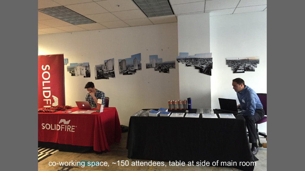 co-working space, ~150 attendees, table at side...