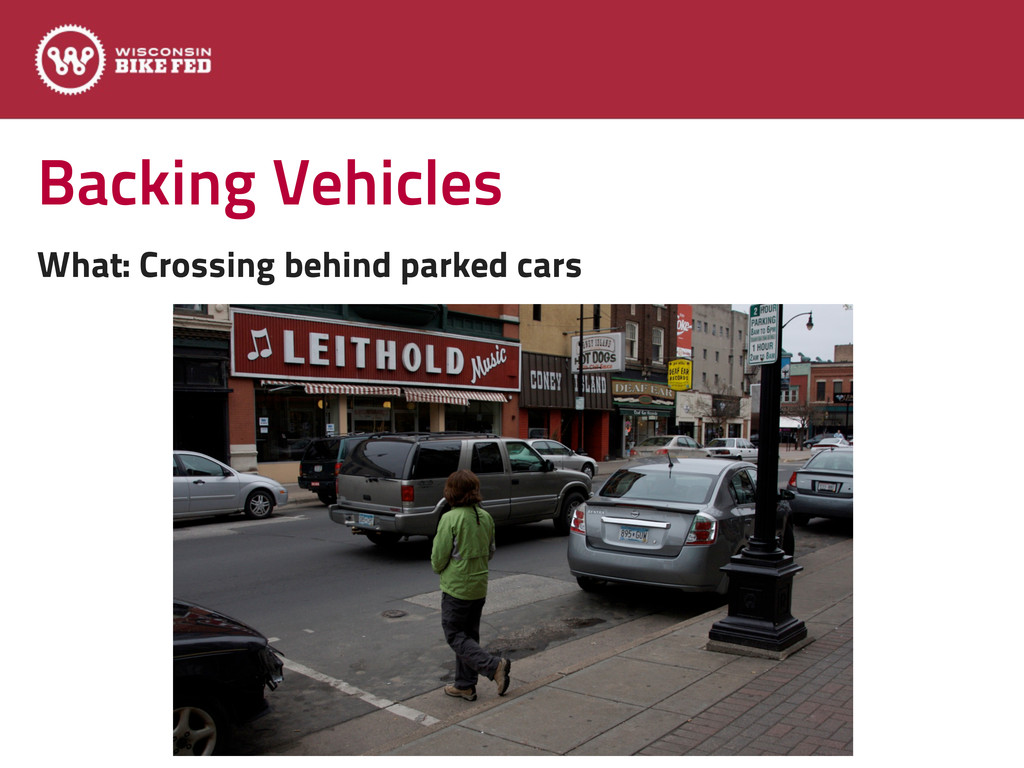 Backing Vehicles What: Crossing behind parked c...
