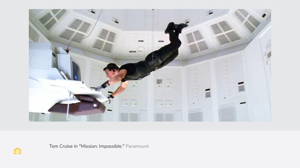 "(Full image slide with caption) Tom Cruise in ""..."