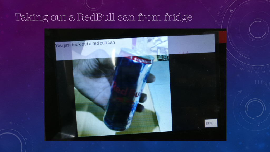 Taking out a RedBull can from fridge