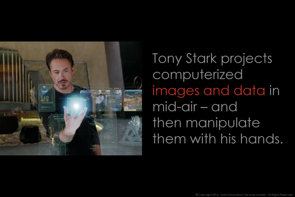 Tony Stark projects computerized images and dat...