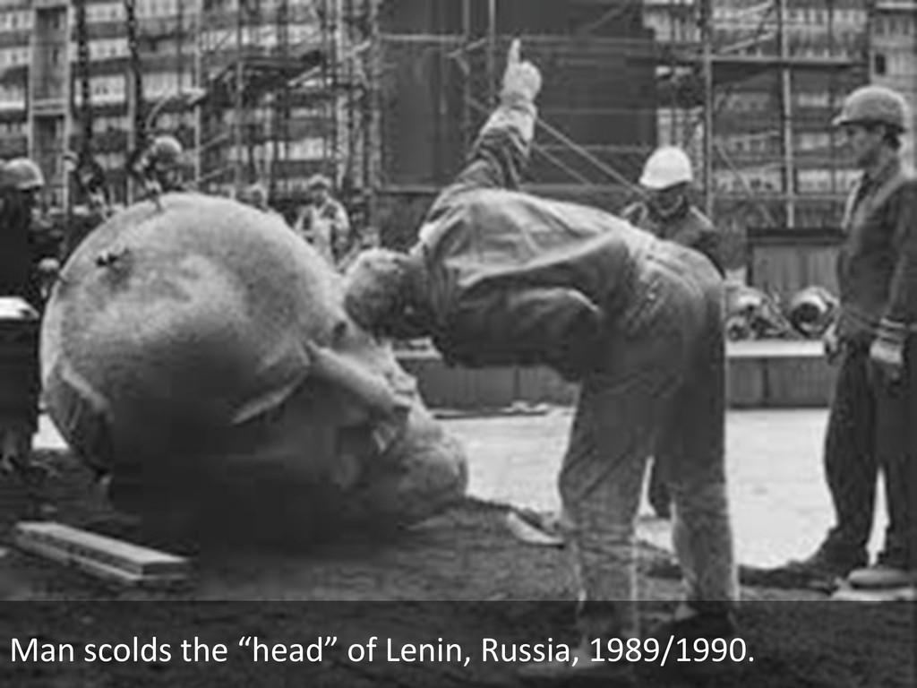 "Man scolds the ""head"" of Lenin,..."