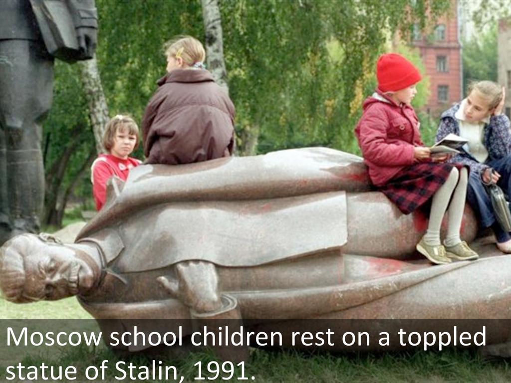 Moscow school children rest on a...