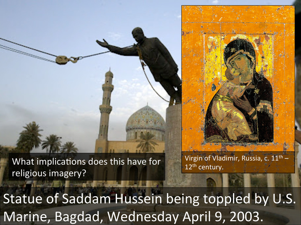 Statue of Saddam Hussein being t...