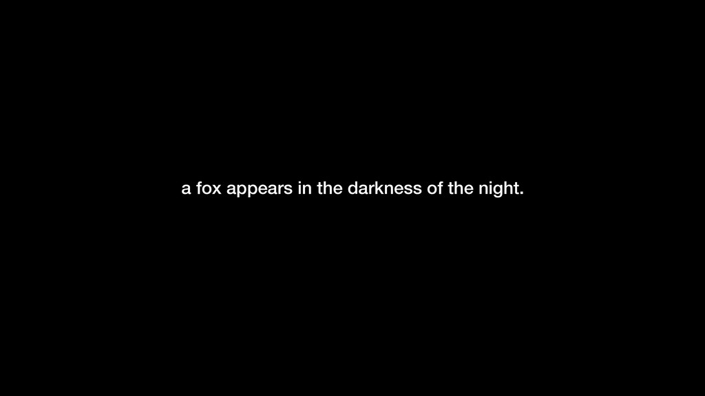 -Gilles Allain a fox appears in the darkness of...