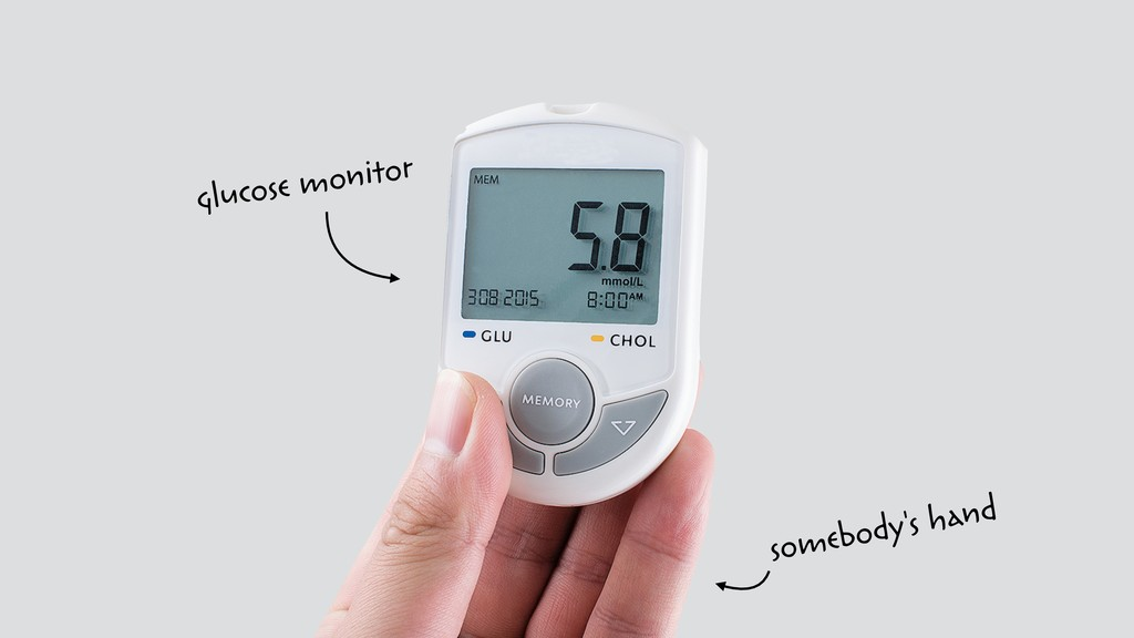 glucose monitor somebody's hand